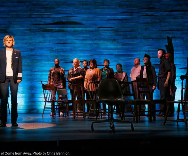"""Jenn Colella, left, as Captain Beverley and the company of """"Come From Away"""" the new musical at Seattle Repertory Theatre. Photo by Chris Bennion."""