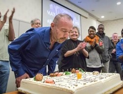 """Timothy Ray Brown celebrates his 10th """"birthday,"""" marking the anniversary of the stem cell transplant that made him the first and so far only person in the world to be cured of the virus that causes AIDS.  Robert Hood / Fred Hutch News Service"""
