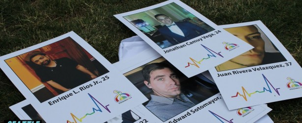 """Placards featuring all 49 victims of Pulse Orlando were held by community members at Seattle's """"We Remembr-Pulse One Year Anniversary"""" event at Cal Anderson Park on Monday, June 12, 2017. Photo: Adam McRoberts for Seattle Gay Scene"""