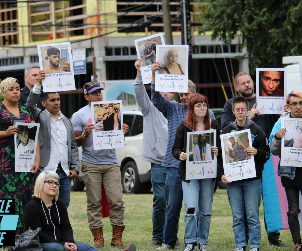 """Placards featuring all 49 victims of Pulse Orlando were held by community members at Seattle's """"We Remember-Pulse One Year Anniversary"""" event at Cal Anderson Park on Monday, June 12, 2017. Photo: Adam McRoberts for Seattle Gay Scene"""