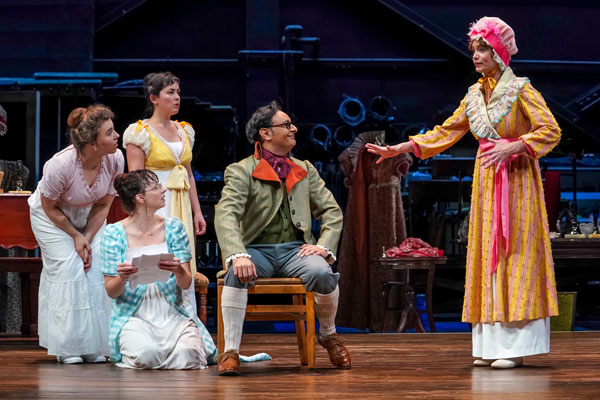 Emily Chisholm (Jane), Kjerstine Anderson (Lizzy), Hana Lass (Lydia), Rajeev Varma (Mr. Bennet), and Cheyenne Casebier (Mrs. Bennet) in Seattle Repertory Theatre's production of Pride and Prejudice. Photo by Alan Alabastro.