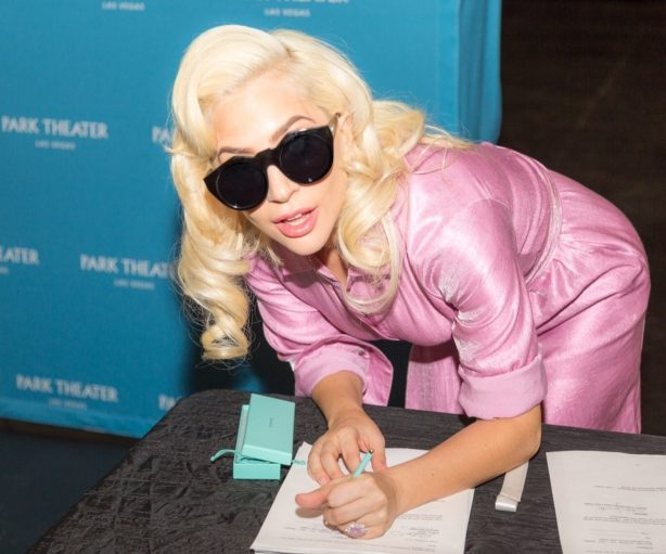 Lady Gaga signs the contract, finalizing her two-year engagement at Park MGM beginning in December 2018. Credit: Alex Dolan (PRNewsfoto/MGM Resorts International)