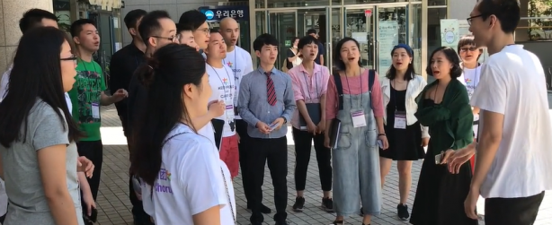 The Beijing Queer Chorus street singing in Seoul Korea in May 2017. Image from a video by Eric Lane Barnes