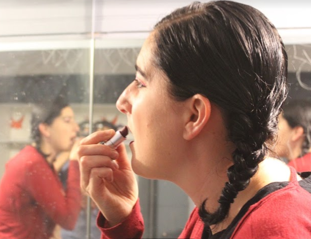 A performer at a previous Subcontinental Drift gets ready backstage.