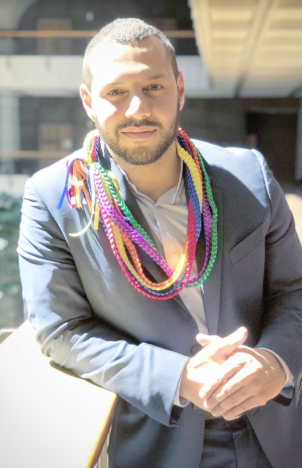 NCLR's Mathew Shurka after his February 20, 2018 testimony at the Hawaii State Capitol, wearing rainbow leis given to him by the LGBT Caucus of the Democratic Party of Hawai'i.