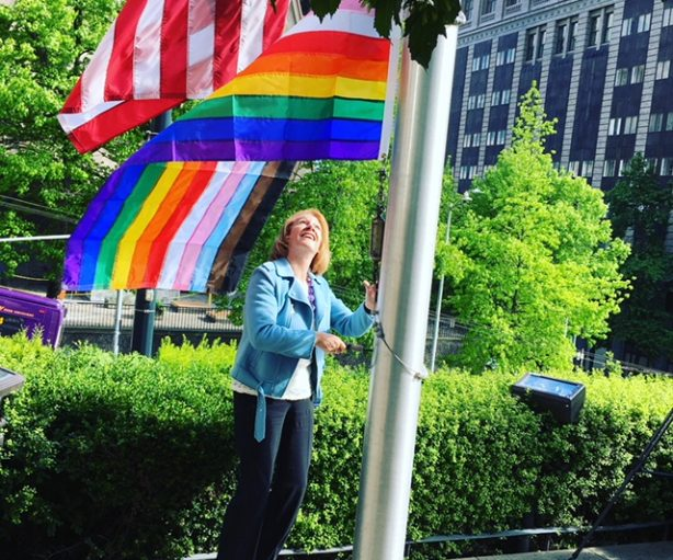 Seattle Mayor Jenny Durkan raises the new Pride Flag at Seattle City Hall on Friday, June 1, 2018. Photo: Michael Strangeways