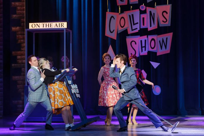 Jason Kappus (Corny Collins), Callie Williams (Tracy Turnblad), Carly Squires Hutchison (Council Member), Ethan Carpenter (Link Larkin), and Jasmine Jean Sim (Council Member) Hairspray Production photo. © 2018 Mark Kitaoka. Property of Village Theatre.