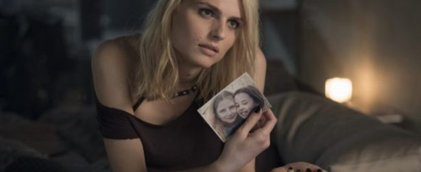 Sofia (Andreja Pejic) on the bed of Lisbeth Salander's apartment in Columbia Pictures' THE GIRL IN THE SPIDERS' WEB.